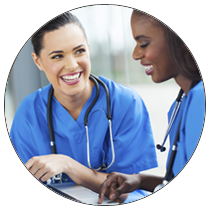 Two nurses smiling - The Essentials of the DNP Program